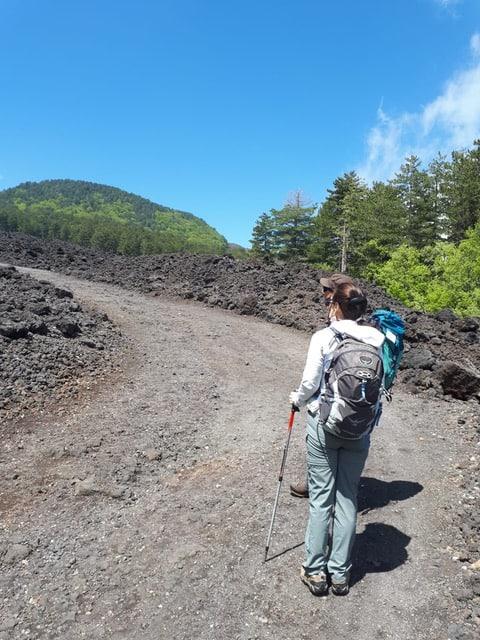 Walking on lava on Mount Etna, Sicily.